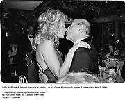 Sally Kirkland & Ahmet Ertegun at Swifty Lazar's Oscar Night party. Spago. Los Angeles. March 1990.<br /><br />© Copyright Photograph by Dafydd Jones<br />66 Stockwell Park Rd. London SW9 0DA<br />Tel 0171 733 0108<br />Film 90231/36