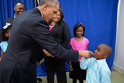 President Barack Obama talks with a young boy about his missing tooth, following a roundtable on consumer protection issues at Lawson State Community College in Birmingham, Ala., March 26, 2015. (Official White House Photo by Pete Souza)<br /> <br /> This official White House photograph is being made available only for publication by news organizations and/or for personal use printing by the subject(s) of the photograph. The photograph may not be manipulated in any way and may not be used in commercial or political materials, advertisements, emails, products, promotions that in any way suggests approval or endorsement of the President, the First Family, or the White House.