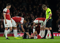 Football - 2018 / 2019 FA Cup - Fourth Round: Arsenal vs. Manchester United <br /> <br /> Sokratis Papastathopoulos (Arsenal FC) provides another injury concern for Arsenal as he lies injured shortly before being substituted at The Emirates Stadium.<br /> <br /> COLORSPORT/DANIEL BEARHAM