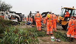 """A large crew of demolition workers start breaking down living areas of the """"Jungle"""" migrant camp, close to Calais in northern France."""