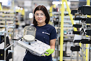 """Mcc0095062 . Daily Telegraph<br /> <br /> 25 yr old Alice Roberts , an Airbus aircraft fitter with an Absorber she has built for the Penlon Ventilator . Alice normally <br /> works on A350 wings  .<br /> <br /> Airbus employees at AMRC Cymru manufacturing parts for the VentilatorChallengeUK consortium which includes corporate names including Airbus, Rolls-Royce and McLaren.  The consortium has supplied 250 ventilators to hospitals, with """"hundreds"""" to follow this week and maximum output slated for early May.<br /> AMRC Cymru is a purpose built research and development facility close to the Airbus wing-manufacturing plant in Broughton, North Wales . 500 operators in total are working around the clock who normally work in aerospace manufacturing and are now building Absorbers and Flow meters for the Penlon Ventilator . <br /> <br /> <br /> <br /> Broughton 22 April 2020"""