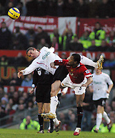 Photo: Paul Thomas.<br />Manchester United v Liverpool. The Barclays Premiership. 22/01/2006.<br /><br />Liverpools Harry Kewell is tackled by Patrice Evra