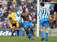 Photo: Scott Heavey.<br />Oxford United v Huddersfeild Town. Nationide Division Three. 06/03/2004.<br />Efe Sodje celebrates the opener