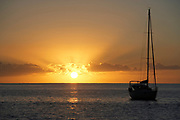View of the sunset and yacht in Gustavia port, St. Barthelemy, FWI