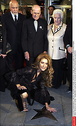 © Andre Pichette/ABACA. 38319-6. Montreal-PQ-Canada, 26/09/2002. Singer Celine Dion poses with husband Rene Angelil,father Adhemar and mother Therese after unveiling her bronze star at he Walk of Fame during a ceremony.