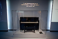 John Lennon piano on display at The Rock and Roll Hall of Fame Annex in New York City..(Photo by Robert Caplin)..