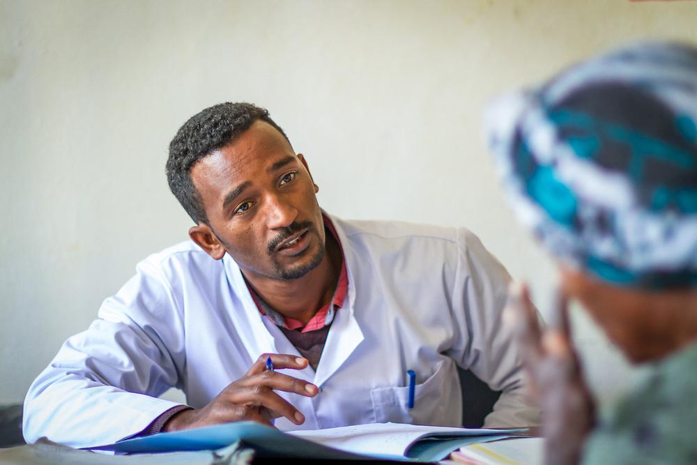 INDIVIDUAL(S) PHOTOGRAPHED: Dr. Endale Gebre Meskel. LOCATION: Mecha Health Center, Bahir Dar, Ethiopia. CAPTION: Dr. Endale Gebre Meskel, Resident of Internal Medicine, seeing a patient.