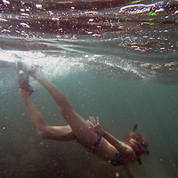 Central America, Costa Rica, Tamarindo. A female snorkeller in the Pacific waters off the coast of Tamarindo.