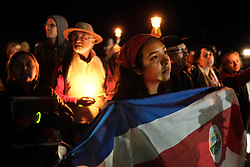 November 16, 2018 - Eloy, Arizona, U.S. - Protesters hold a candlelight vigil at the Eloy Detention Center to highlight conditions at the prison and the illegal incarceration of detainees. Eloy is a private prison owned and operated by CoreCivic under a contract with US Immigration and Customs Enforcement. Illegal immigrants are held at the facility while they await a hearing before a judge . The protest was organized by the Puente Human Rights movement. Supporters called for the abolishment of I.C.E and rights of migrants. (Credit Image: © Christopher Brown/ZUMA Wire)