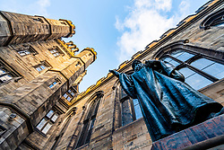 Statue of John Knox in courtyard of New College at the University of Edinburgh, the Faculty of Divinity, on The Mound in Edinburgh Old Town, Scotland, UK