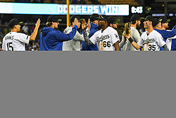 May 28, 2018 - Los Angeles, CA, U.S. - LOS ANGELES, CA - MAY 28: Los Angeles Dodgers Right field Yasiel Puig (66) and Los Angeles Dodgers First base Cody Bellinger (35) get high fives after a MLB game between the Philadelphia Phillies and the Los Angeles Dodgers on Memorial Day, May 28, 2018 at Dodger Stadium in Los Angeles, CA. (Photo by Brian Rothmuller/Icon Sportswire) (Credit Image: © Brian Rothmuller/Icon SMI via ZUMA Press)