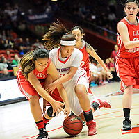 031114  Adron Gardner/Independent<br /> <br /> Robertson Cardinal Ashley John (33), left, and Shiprock Chieftain Chantel Sena (20) collide during the state high school basketball tournament at The Pit in AlbuquerqueTuesday.