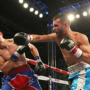 TAMPA, FL - FEBRUARY 28:  Christopher Diaz (R) lands a punch on Luis Ruiz Jr. during the SoloBoxeo Tecate boxing match at the University of South Florida Sundome on February 28, 2015 in Tampa, Florida. Diaz won the bout by unanimous decision.   (Photo by Alex Menendez/Getty Images) *** Local Caption *** Christopher Diaz; Luis Ruiz Jr.
