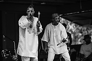LIGNUM, VA -- 7/23/16 -- Diaspora Blac (cq) performs during Mustock. At left is Baba Femi and at right is Mr. Seifu. <br /> Mustock is a private music festival hosted by DC based musician, Mustafa Akbar. Now in it's 17th year, the event started as a fish-fry with Mustafa's mother when she was still living. Originally open to family and close friends, the event has grown steadily, and drew roughly 300 people over the weekend.…by André Chung #_AC14135