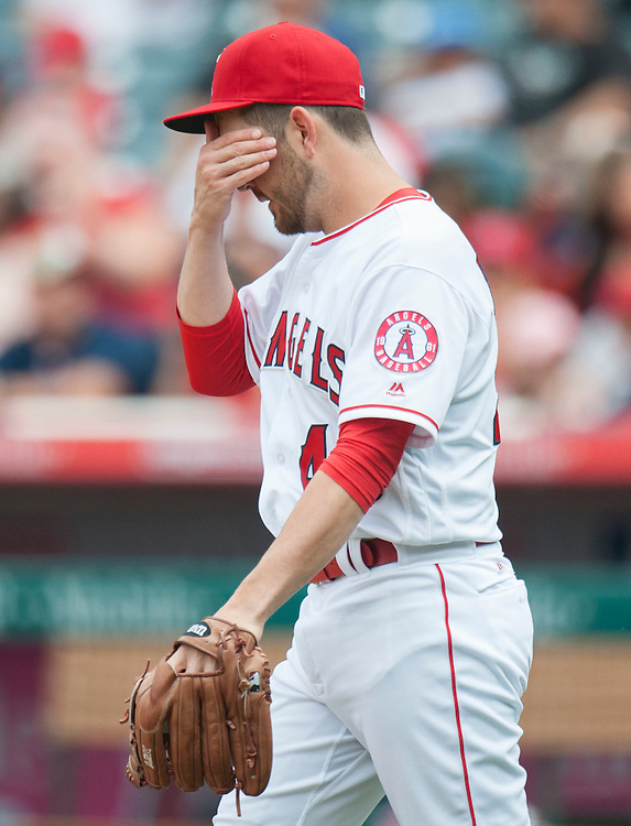 The Angels' Cory Rasmus wipes his face after allowing a run in the seventh inning during the Angels' 8-3 loss to the Cleveland Indians Sunday at Angel Stadium.<br /> <br /> ///ADDITIONAL INFO:   <br /> <br /> angels.0612.kjs  ---  Photo by KEVIN SULLIVAN / Orange County Register  -- 6/12/16<br /> <br /> The Los Angeles Angels take on the Cleveland Indians Sunday at Angel Stadium.
