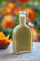 Garcia's green chilli sauce in a bottle with tortilla chips