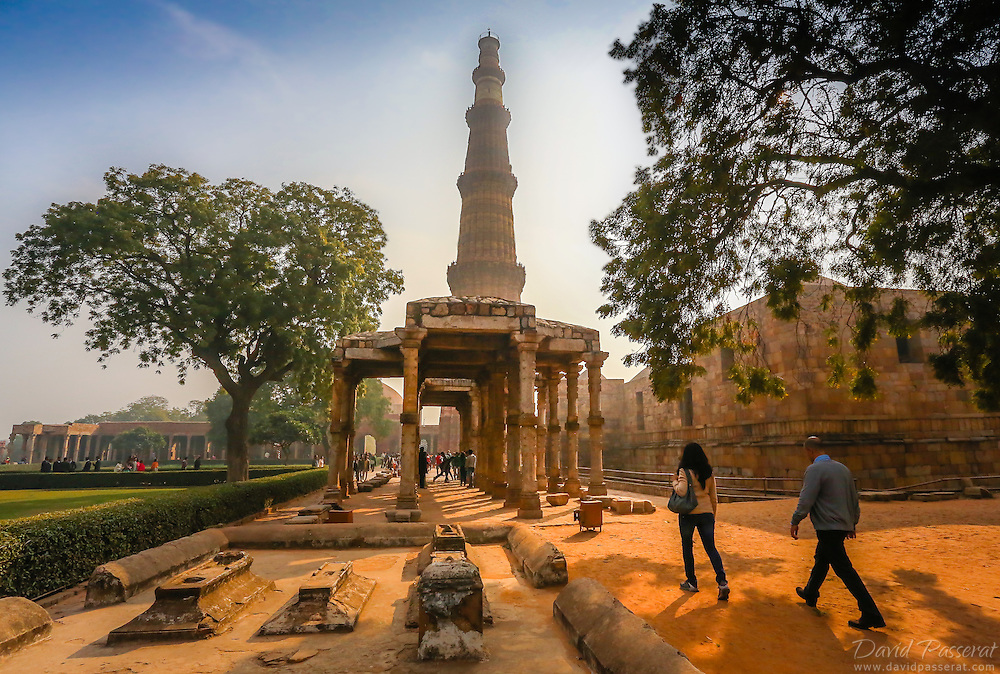 Photo taken in the Qutub (or Qutab) Minar archeological parc. Qutab Minar is the tower seen in the center of the picture. This moument is a soaring, 73 m-high tower of victory, built in 1193 by Qutab-ud-din Aibak immediately after the defeat of Delhi's last Hindu kingdom.
