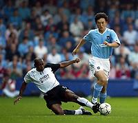 Photo. Aidan Ellis.<br />Fulham v Manchester City.<br />Barclaycard Premiership.<br />20/09/2003.<br />Fulham's Louis Boa Morte and City's Jihai Sun