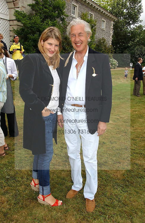 """MARTIN SUMMERS and his daughter TARA SUMMERS at the Goodwood Festival of Speed on 9th July 2006.  Cartier sponsored the """"Style Et Luxe' for vintage cars on the final day of this annual event at Goodwood House, West Sussex and hosted a lunch.<br /><br />NON EXCLUSIVE - WORLD RIGHTS"""
