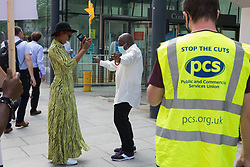 London, UK. 20th July, 2021. Members of the PCS trade union working for the outsourced contractor ISS dance on the picket line outside their workplace at the Department for Business, Energy and Industrial Strategy (BEIS) on the second day of a 3-day strike. The striking cleaners, security guards and other support staff at the government department are demanding an end to low pay, improved working conditions, bonuses for having worked through lockdown, annual leave from last year and a Covid return-to-work protocol.