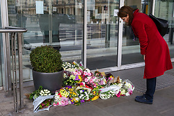 © Licensed to London News Pictures. 16/03/2019. London, UK. A woman reads the messages left at High Commission of New Zealand in London. A gunman killed 49 worshippers at the Al Noor Masjid and Linwood Masjid mosques in Christchurch, New Zealand on 15 March. The 28-year-old Australian suspect, Brenton Tarrant, appeared in court on 16 March and was charged with murder. Photo credit: Dinendra Haria/LNP