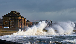 Saltcoats, Scotland, UK. 9 February, 2020.  Storm Ciara creates large waves breaking over seawall at Saltcoats in Ayrshire. Train services on the adjacent railway have been interrupted. With high tide due at midday and winds expected to increase in speed later in the day, the height of the waves are expected to dramatically increase Iain Masterton/Alamy Live News.