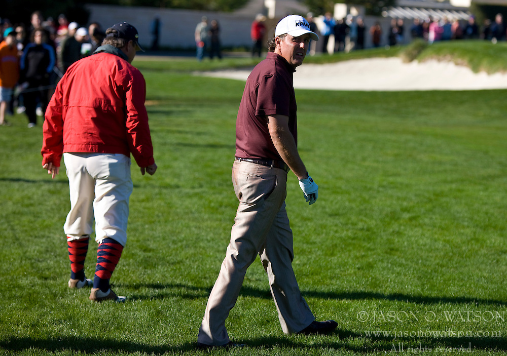 February 14, 2010; Pebble Beach, CA, USA;  Phil Mickelson searches for his ball on the third hole during the final round of the AT&T Pebble Beach Pro-Am at Pebble Beach Golf Links.
