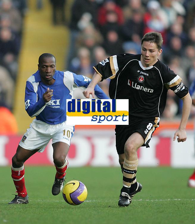 Photo: Lee Earle.<br /> Portsmouth v Charlton Athletic. The Barclays Premiership. 20/01/2007.Pompey's new signing Lauren (L) tracks Charlton's Matt Holland.