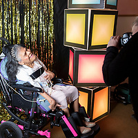 """Joan Keetso takes a prom photo at """"Night to Shine,"""" Friday, Feb. 8, at New Life Christian Assembly Church in Pinedale. """"Night to Shine"""" is a prom for local teens and adults with special needs sponsored by the Tim Tebow Foundation."""
