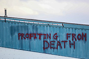 """Tamworth, United Kingdom, May 25, 2021: """"Profiting from Death"""" is a graffiti the """"Palestine Action"""" activists group painted after they occupied an Israeli owned weapons manufacturer building in Tamworth, Amington Industrial Estate near Birmingham on Tuesday, May 25, 2021. """"Shut Elbit Down"""", """"Free! Free! Palestine"""" are among the slogans activists shouted whilst on the rooftop of the building. (Photo by Vudi Xhymshiti)"""
