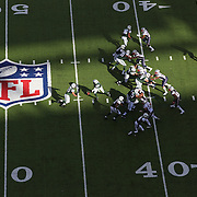 A general view of action in the late afternoon sunshine showing the NFL logo and field markings during the New York Jets V New England Patriots NFL regular season game at MetLife Stadium, East Rutherford, NJ, USA. 20th October 2013. Photo Tim Clayton