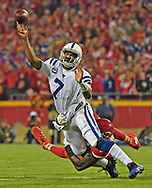 Quarterback Jacoby Brissett #7 of the Indianapolis Colts throws a pass under pressure from defensive end Tanoh Kpassagnon #92 of the Kansas City Chiefs during the first half at Arrowhead Stadium in Kansas City, Missouri.