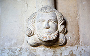 Carved stone head and face Church of Saint Katherine and Saint Peter, Winterbourne Bassett, Wiltshire, England, UK