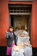 Street vendor selling assortment of native breads and sweets, lima, Peru, South America