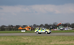"""Saturday 27th February 2016Emergency services at Conington Airfield near Holme after light plane crash injures one<br /> <br /> <br /> The emergency services are at Conington Airfield near Holme after a light airplane crash left one person with multiple broken bones.<br /> <br /> <br /> Cambridgeshire police were called just before 11.30am this morning (Saturday, February 27) and are assisting ambulance crews and the fire service.<br /> <br /> <br /> <br /> A Magpas air ambulance was also at the scene.<br /> <br /> A police spokesman confirmed that a Microlight plane had crashed at the airfield (which it referred to as the Peterborough Business Airport) with one casualty suffering """"multiple broken bones.""""<br /> <br /> The spokesman added that the Air Accident Investigation Branch were aware of the incident.<br /> <br />  ©UKNIP"""