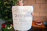 16 MAY 2011 - PHOENIX, AZ: A medicare supporter at a town hall meeting in Phoenix Monday. About 200 people attended Congressman Ben Quayle's (R-AZ) town hall meeting in the Anthem neighborhood of Phoenix, AZ, Monday. Quayle, son of former Vice President Dan Quayle, was elected in the Republican tide that captured the House of Representatives in Nov. 2010. Quayle tried to run under a Tea Party banner. Most of the people in the crowd were hostile to Quayle and the GOP budget proposal that would change medicare to a voucher system and Quayle was shouted down several times when he tried to support the budget.     Photo by Jack Kurtz