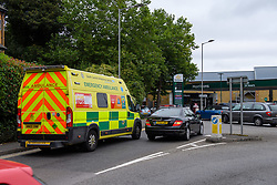 © Licensed to London News Pictures. 25/09/2021. High Wycombe, UK. An ambulance queues at a Morrisons petrol station in High Wycombe as panic buying takes hold following reports of fuel shortages due to delivery difficulties in the supply chain across in the UK because of a lack of HGV drivers. Photo credit: Peter Manning/LNP
