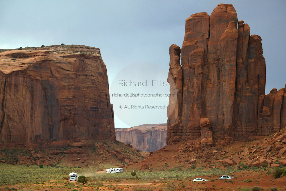 Traffic in Monument Valley during the summer tourist season on the southern border of Utah with northern Arizona. The valley lies within the range of the Navajo Nation Reservation. The Navajo name for the valley is Tsé Bii' Ndzisgaii - Valley of the Rocks.