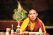 Buddhist monk with ceremonial attributes at Hemis Monastery, Leh, Ladakh, India