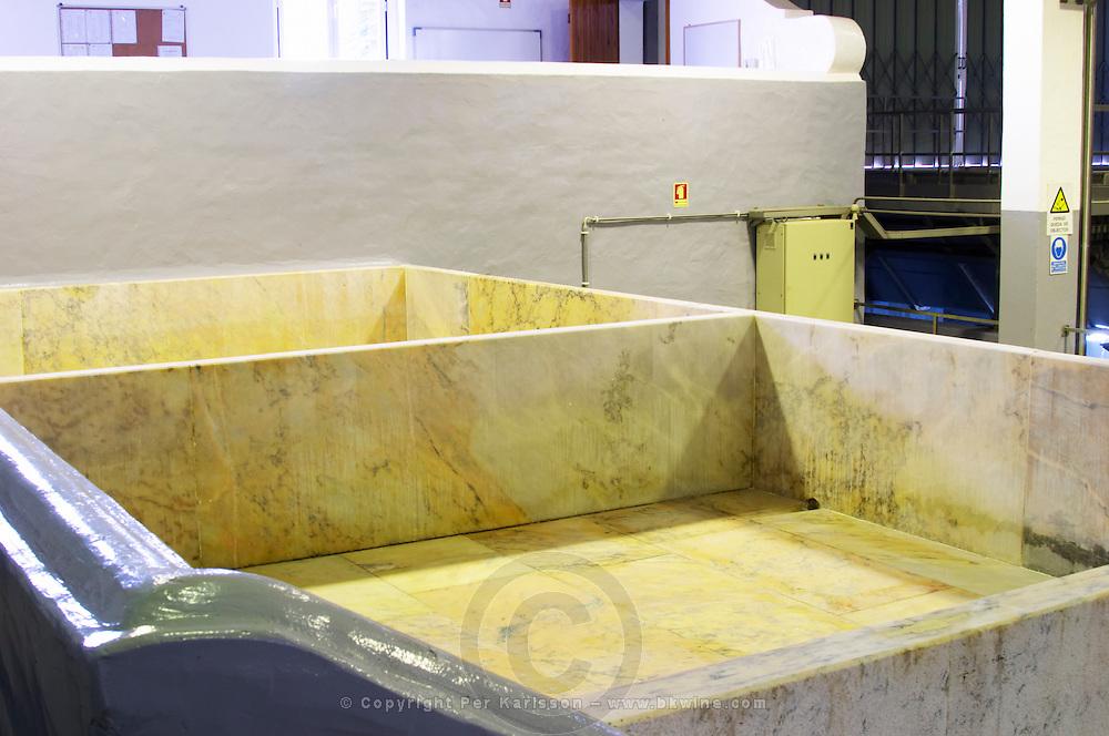 Lagares, Portuguese low and wide maceration vats. J Portugal Ramos Vinhos, Estremoz, Alentejo, Portugal
