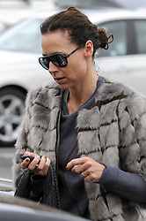EXCLUSIVE: Minnie Driver wears a ring on her engagement finger as she leaves the same Soul Cycle class Beckham attends in LA! Minnie was seen make up free wearing big sunglasses as she headed to her car after leaving the class in Brentwood. Beckham was at the same class that morning. Minnie who has recently been linked to Neville Wakefield as the pair were spotted at the NY fashion week, wore the ring as she headed to the car after the cycle class in LA. 07 Apr 2015 Pictured: Minnie Driver. Photo credit: MEGA TheMegaAgency.com +1 888 505 6342