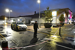 © Licensed to London News Pictures. 11/10/2018. London, UK. The scene at a Lidl Supermarket in Hayes where a man is believed to have been shot before fleeing in a Mercedes car which later crashed. The victim died at the crash scene. Photo credit: Ben Cawthra/LNP