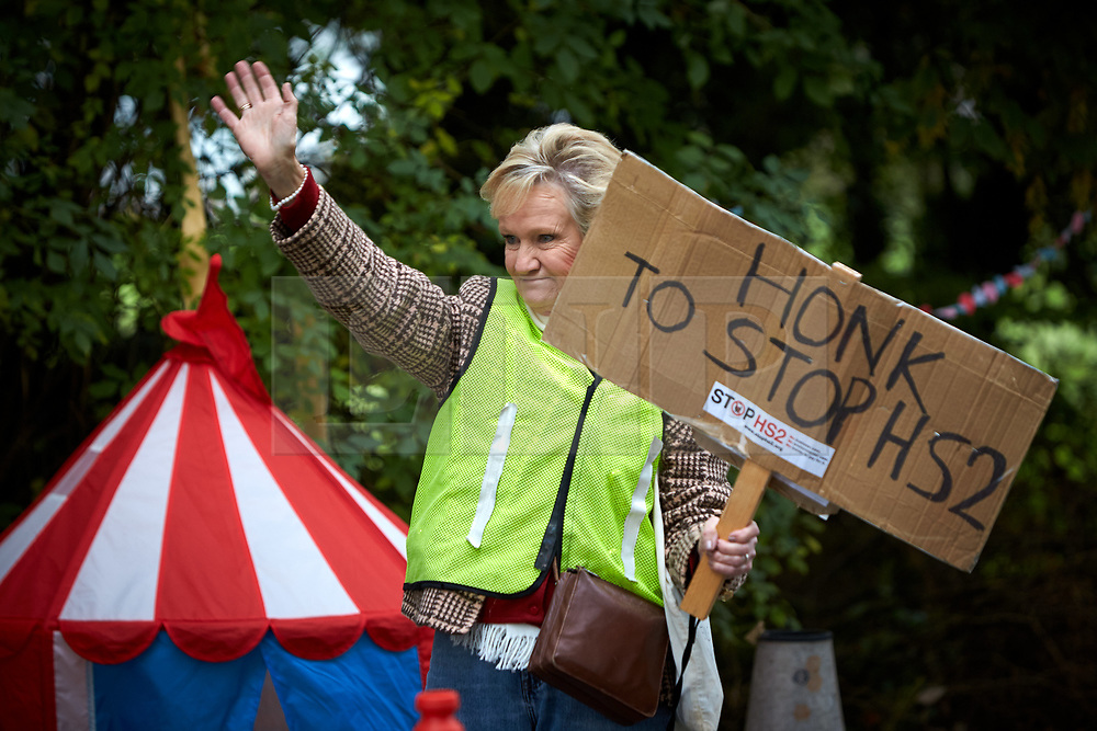 © Licensed to London News Pictures. 23/10/2019. GREAT MISSENDEN, UK.  Enabling works to allow the construction of the HS2 railway continue despite the future of the project being reviewed. A number of mature trees were due to be felled last week to allow easier access for construction traffic but local residents and climate activists created a makeshift camp to prevent their destruction. In this picture: ANN HAYWARD, who lives in nearby Wendover which will be heavily impacted by HS2, at the protest site. Photo credit: Cliff Hide/LNP