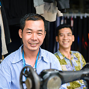 Tailor at a market in Ho Chi Minh City