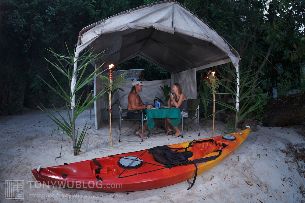 Ron Leidich and Terry Ward having a chat in our dinner tent at Blue Devil Beach, where we camped for the first three nights of our trip to explore the Rock Islands of Palau by kayak.
