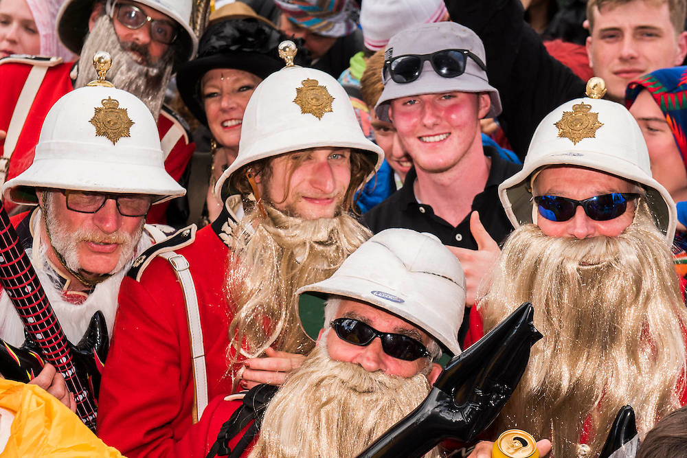 fans in fancy dress and big beards watch as ZZ Top play the Pyramid Stage - The 2016 Glastonbury Festival, Worthy Farm, Glastonbury.