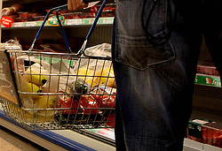File photo dated 22/07/09 of a person shopping in a supermarket. Food prices have rolled back from a three-and-a-half-year high as pressure from the Brexit-hit pound eased last month, new figures show.
