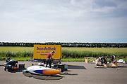Het team preparteert zowel de VeloX 4 (links) als de VeloX V. Op de RDW baan in Lelystad wordt getest met de VeloX 4, de fiets van vorig jaar, en voor het eerst ook met de nieuwste fiets, de VeloX V. In september wil het Human Power Team Delft en Amsterdam, dat bestaat uit studenten van de TU Delft en de VU Amsterdam, een poging doen het wereldrecord snelfietsen te verbreken, dat nu op 133,8 km/h staat tijdens de World Human Powered Speed Challenge.<br /> <br /> At the RDW track in Lelystad the team tests wit the VeloX 4 and for the first time with the VeloX V. With the special recumbent bike the Human Power Team Delft and Amsterdam, consisting of students of the TU Delft and the VU Amsterdam, also wants to set a new world record cycling in September at the World Human Powered Speed Challenge. The current speed record is 133,8 km/h.