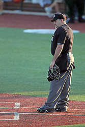17 August 2013:  Umpires Chuck Adya during a Frontier League Baseball game between the Rockford Aviators and the Normal CornBelters at Corn Crib Stadium on the campus of Heartland Community College in Normal Illinois