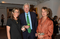 Left to right, SARAH HOLLAND-HIBBERT and VISCOUNT & VISCOUNTESS WINDSOR at a reception to celebrate the publication of Hockney - A Pilgrim's Progress by Christopher Simon Sykes held at Sotheby's, New Bond Street, London on 30th September 2014.